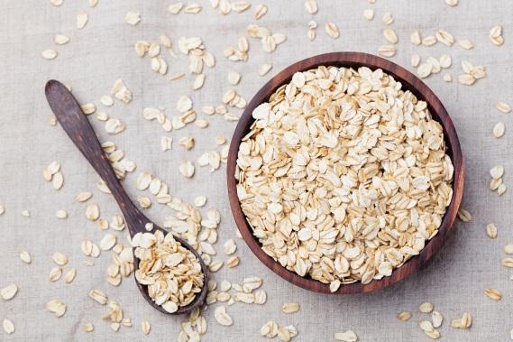 Healthy breakfast Organic oat flakes in a wooden bowl